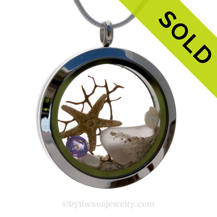 Purple sea glass combined with beach sand ,a real starfish and brightened up with an amethyst crystal gem and pearls makes this a great choice for a February Birthday! SOLD - Sorry this Sea Glass Jewelry selection is NO LONGER AVAILABLE!