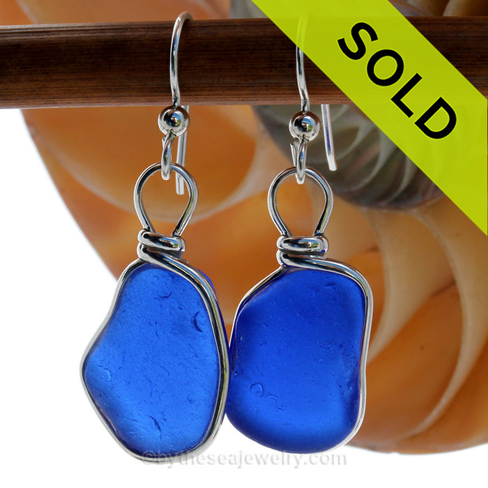 Very Large and Thick Genuine Bright Cobalt Blue Sea Glass Earrings in our Original Wire Bezel© Sterling Silver setting. Our original Wire Bezel Earring setting lets all the beauty of these beauties shine! This setting does not alter the sea glass from the way it was found on the beach.