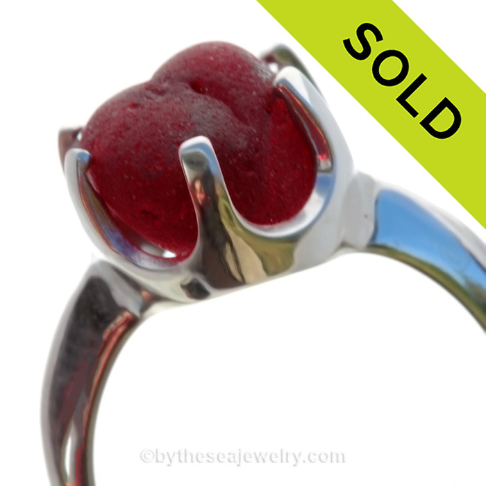 A stunning piece of PERFECT VIVID mixed Deep Red Victorian Era vivid sea glass set in a secure solid sterling 6 prong ring.