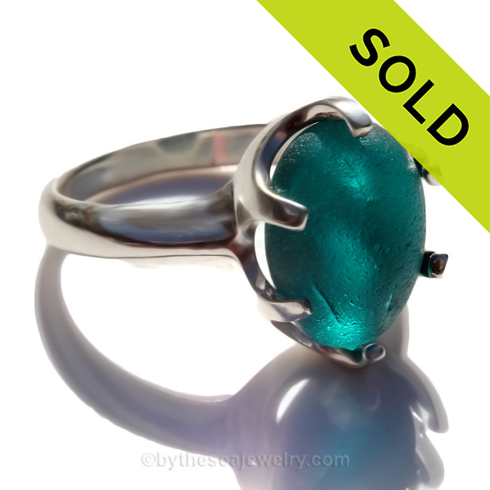 Amazing sea glass from Seaham England in a solid sterling ring in a  true vivid electric aqua.