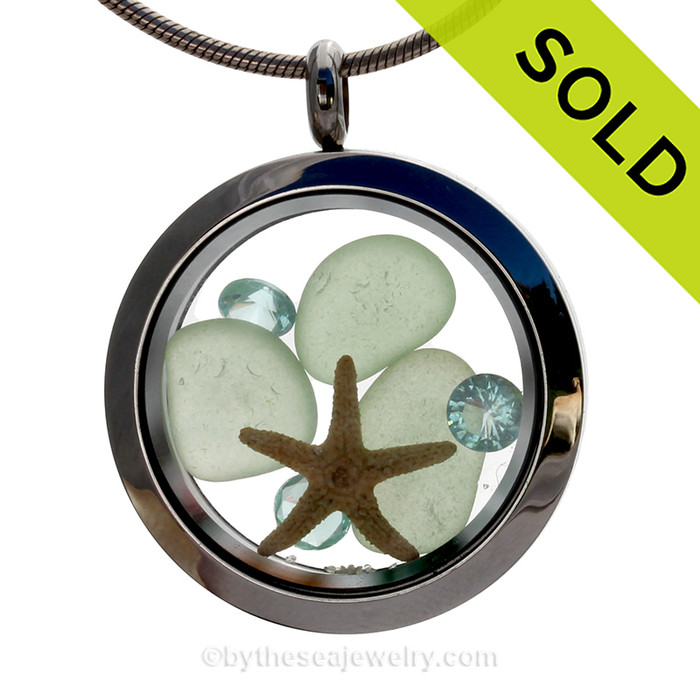 Pretty Pastels of Seafoam Green inside this crystal and stainless steel locket combined with a baby starfish and  Aquamarine crystal gems. SOLD - Sorry this Sea Glass Locket is NO LONGER AVAILABLE!