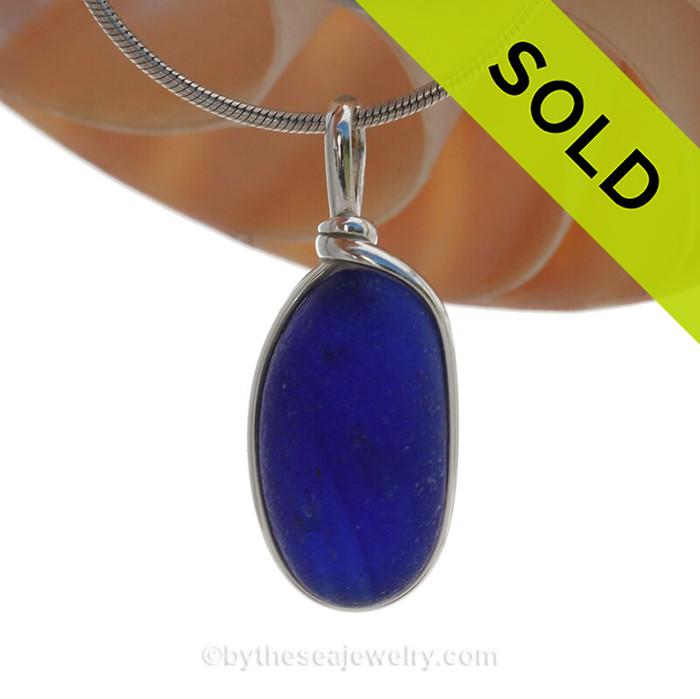 A larger and thick piece of very Deep Cobalt Blue English Sea Glass set in our Original Deluxe Wire Bezel© Necklace Pendant.