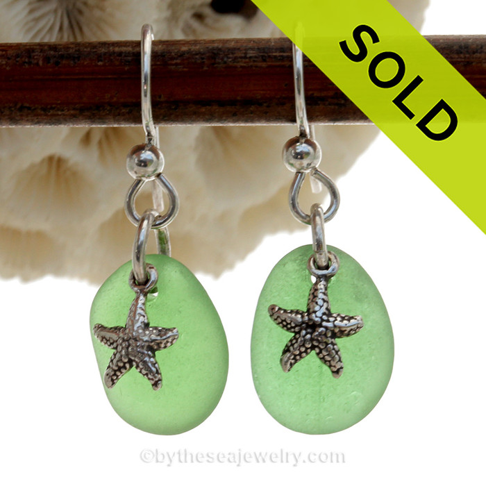 A simple pair of genuine green sea glass earrings with sterling Starfish charms in a lightweight simple setting.