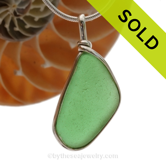 This is a Very Nice and neat shape of Green Sea Glass set in our Original Wire Bezel© pendant setting in Sterling Silver . This is our signature Original Wire Bezel© design that leaves the glass UNALTERED from the way it was found on the beach. Beautiful, Classic and Versatile.