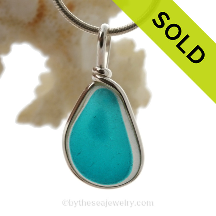 A Lovely Petite Flashed Electric Aqua multi sea glass set in Sold Sterling Silver Deluxe Wire Bezel© pendant setting.
