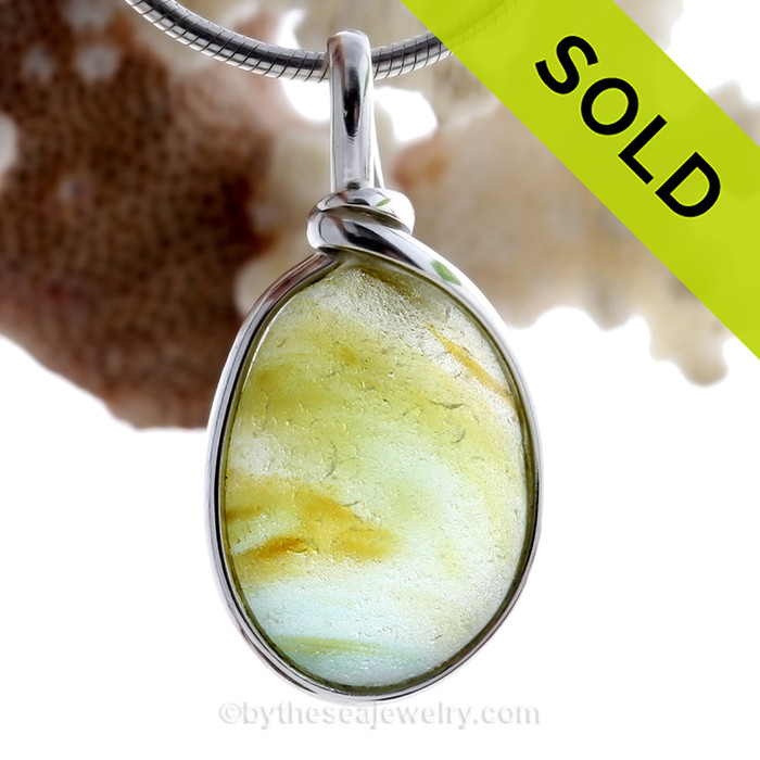 A Lovely Petite Mixed  Bright Spring Green and a touch of Aqua Blue multi sea glass set in Sold Sterling Silver Deluxe Wire Bezel© pendant setting.