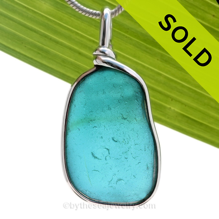 GLOWING Genuine Beach found ELECTRIC Turquoise Sea Glass in our Original Wire Bezel© pendant setting in solid sterling silver.