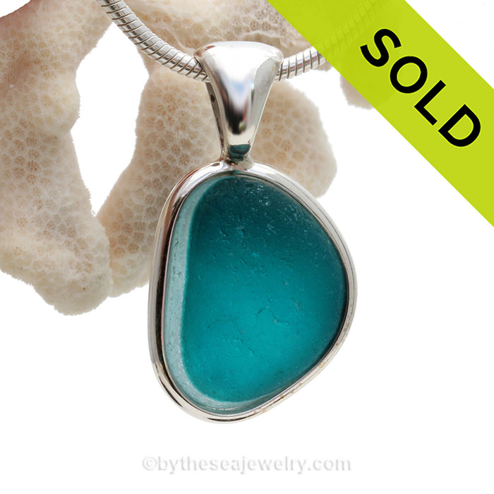This is a stunning ULTRA RARE Flashed Electric Aqua or Turquoise English Multi sea glass set for a necklace in our Deluxe Sea Glass Bezel© in solid sterling silver setting.