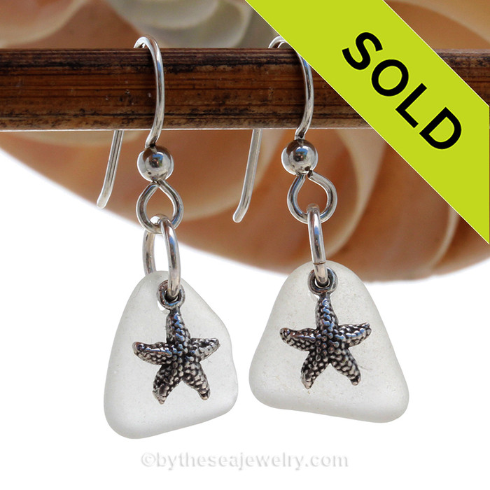 Perfect white sea glass earrings in sterling with sterling starfish charms.
