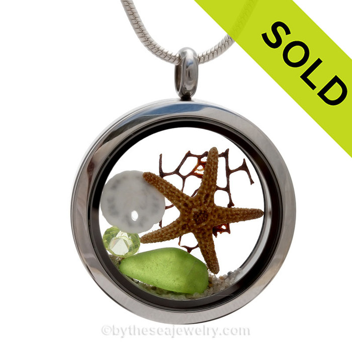 Genuine Vivid Lime or Peridot Green combined with a real starfish, a baby sandollar, a crystal Peridot Green gem, a bit of sea fan and real beach sand in this screw top stainless steel locket. SOLD - Sorry this Sea Glass Locket Necklace is NO LONGER AVAILABLE!
