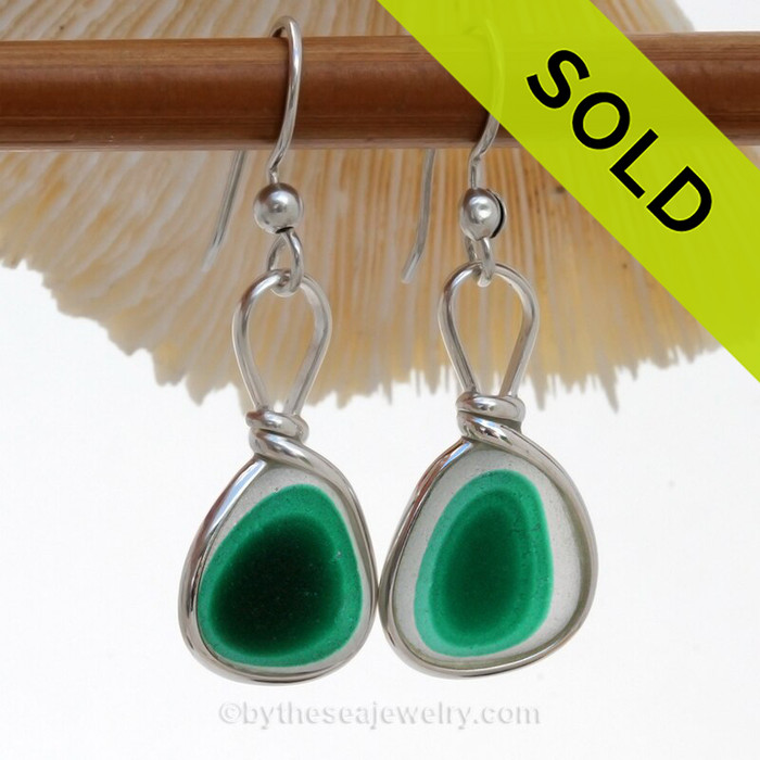 Two stunning vibrant green sea glass that originated as scrap art glass set in our Sterling Silver Original Wire Bezel© setting that leaves the sea glass UNALTERED from the way it was found on the beach.