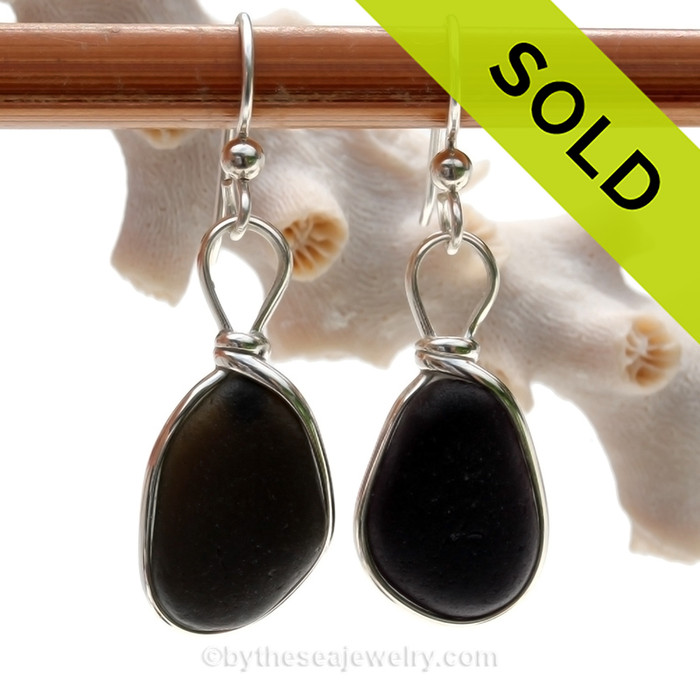 Ultra rare black sea glass set in our Original Wire Bezel earring setting in sterling silver. Hard to match natural sea glass pieces from England.