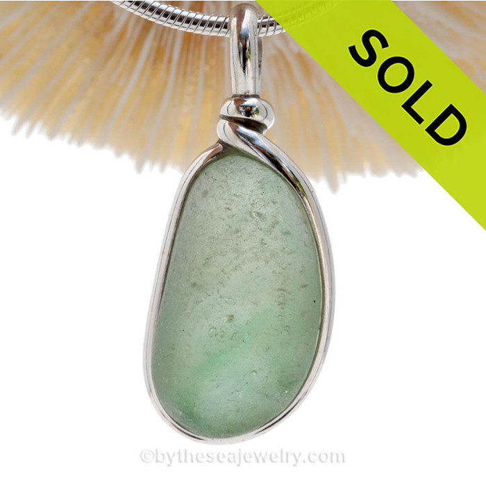 This is a soft subtle mixed of  Green end of day Sea Glass in a Pendant In Original Wire Bezel Setting©