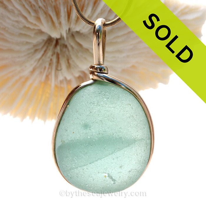 A LARGE and THICK beach found Sea Green Genuine Sea Glass Pendant in our Original Wire Bezel in 14K Rolled Gold This is our Original Wire design that leaves the glass UNALTERED from the way it was found on the beach.  The 14K goldfilled bezel makes this a classic and timeless piece of jewelry.