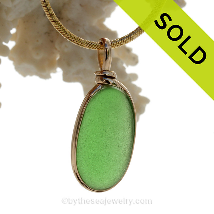 A lovely piece of perfect green Genuine Sea Glass set in our Original Wire Bezel© setting in 14K Rolled Gold