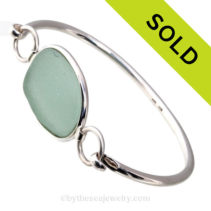 Genuine Oval Seafoam Green Sea Glass Bangle Bracelet set in our Premium Deluxe Wire Bezel© sterling silver setting.