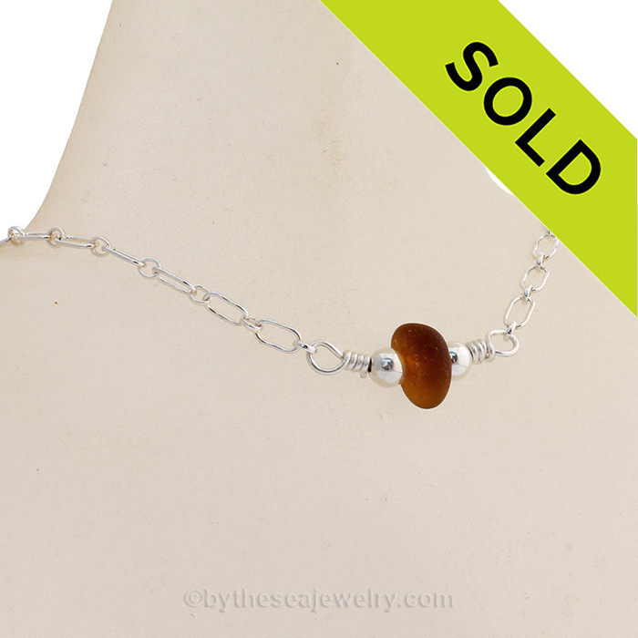 A perfect piece of Glowing Caramel Brown Natural Genuine Sea Glass on a Sterling Long and Short Link Chain. Beautiful well aged natural sea glass shaped only by tide and time! All Solid Sterling Elements Top Quality Small Solid Sterling Lobster Claw Clasp.