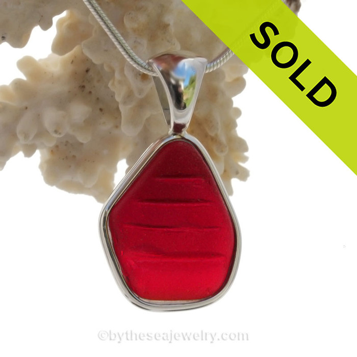 This AMAZING Embossed Vivid Cherry Red Genuine Sea Glass set in Solid Sterling Silver Deluxe Wire Bezel setting. This setting leaves this amazing natural sea glass piece just the way it was found on  the beach!  WOW your friends and family with this amazing piece, such and intense color it was hard to photograph and looks much more amazing in person