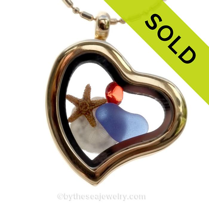 Cobalt Blue Beach Found Sea Glass Heart Goldtone Locket Necklace W/ a real baby sandollar and starfish.