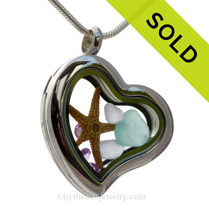 Beautiful pieces of Lavender and an Aqua Blue sea glass pieces combined with a real starfish and a premium Amethyst Gems in this Genuine Sea Glass Heart Locket Necklace. SOLD - Sorry This Sea Glass Jewelry Item is NO LONGER AVAILABLE!