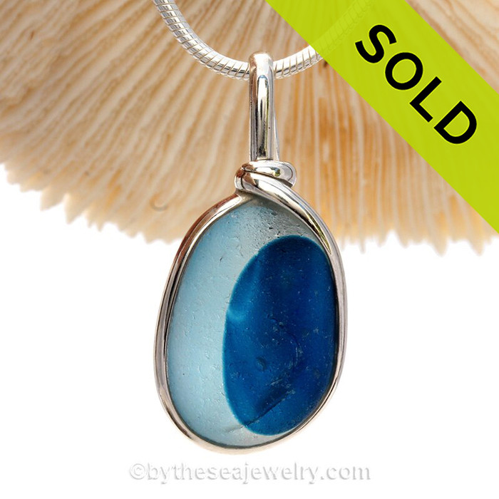 A Lovely shaped Mixed Aqua Blue and White Seaham multi sea glass set in Sold Sterling Silver Deluxe Wire Bezel© pendant setting.