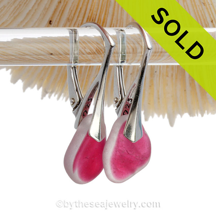 Vivid and VERY RARE Hot Pink Genuine Sea Glass pieces really glow hanging from these Solid Sterling Silver Leverback Earrings. The color is NOT applied but was incorporated into the glass over 100 years ago! Flashed sea glass from this region of England is the result of scrap art glass destined for window panels and decorative housewares in the Victorian era. The scrap was tossed into the sea. These lovely frosted Natural sea glass gems are the result.