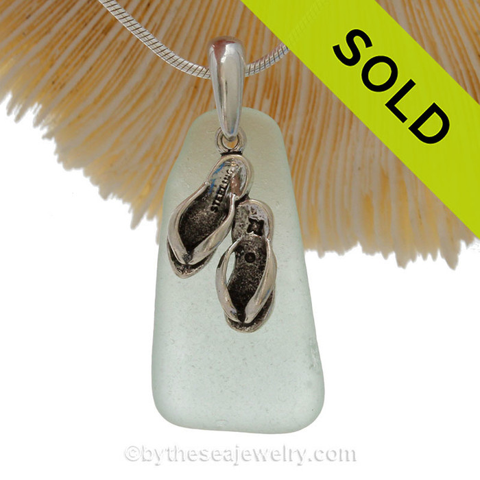 Perfect Pale Aqua Green sea glass necklace set on a solid sterling cast bail with a sterling silver Flip Flop charm.