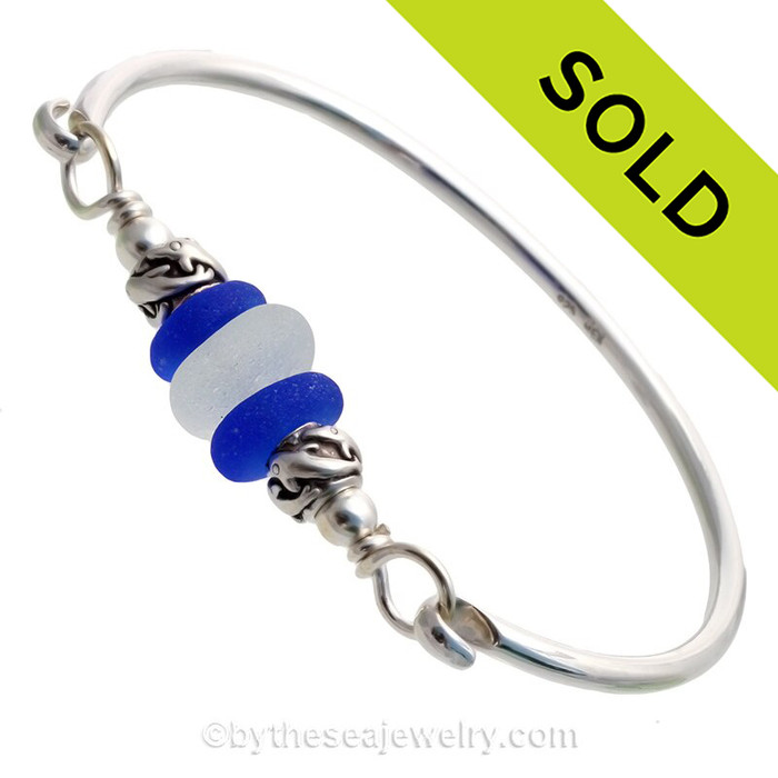 Perfect Pure White English Sea Glass combined with two vivid Blue Recycled Glass Beads on this Solid Sterling Silver Premium Sea Glass Bangle Bracelet.