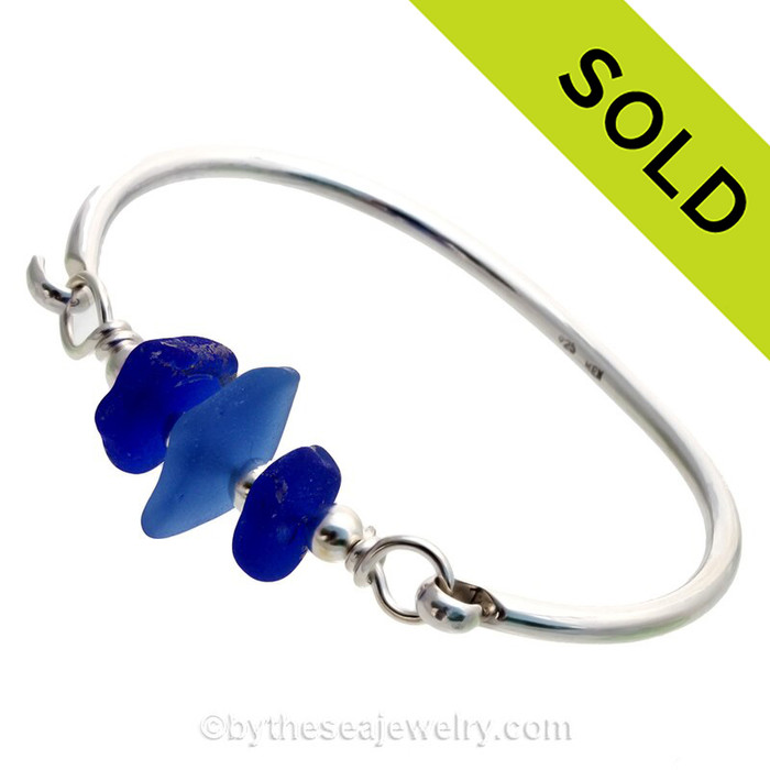 Lucky Cobalt and Medium Blue Sea Glass combined Solid Sterling Beads on this Solid Sterling Silver Premium Sea Glass Bangle Bracelet.