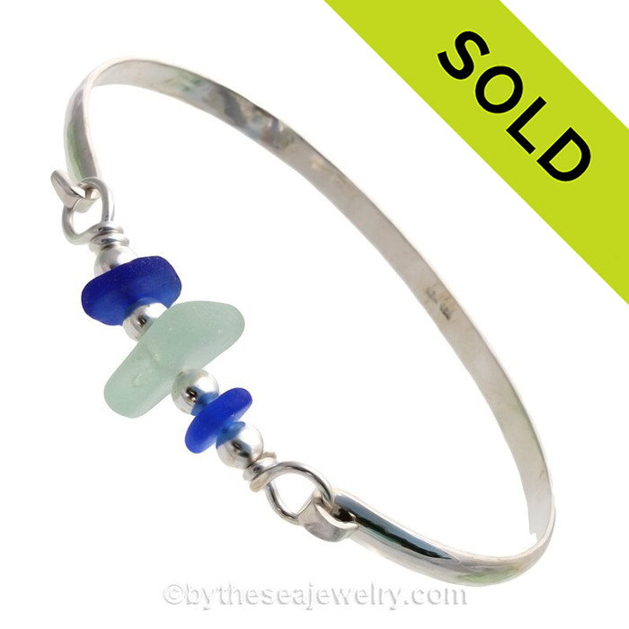 Lucky Cobalt and Soft Summery Sea Green Sea Glass combined Solid Sterling Beads on this Solid Sterling Silver Premium Sea Glass Bangle Bracelet.