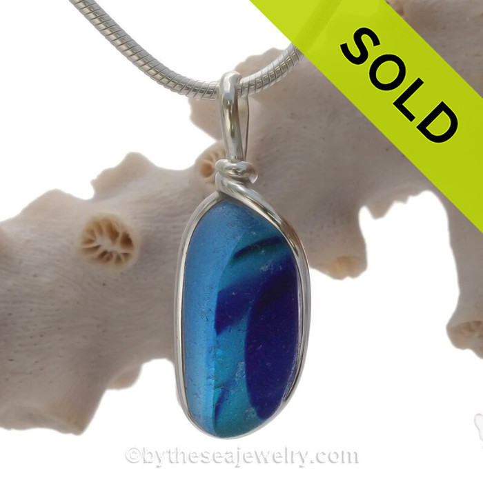 A Lovely shaped Mixed Blue Seaham multi sea glass set in Sold Sterling Silver Deluxe Wire Bezel© pendant setting.