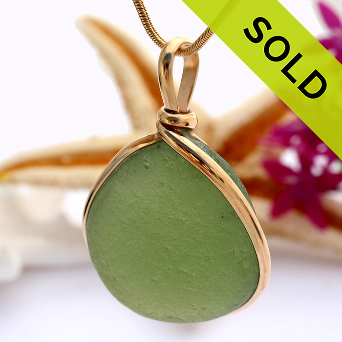 A perfect piece of seaweed green sea glass from England set in our Original Wire Bezel setting. Sorry this sea glass jewelry selection has been sold!