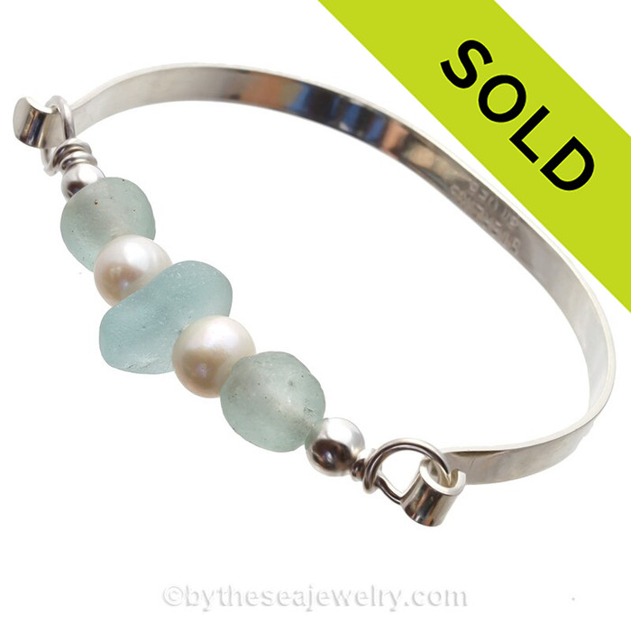 SOLD - Sorry this Sea Glass Jewelry selection is NO LONGER AVAILABLE! A Center of beach found pale aqua blue sea glass combined with seafoam recycled glass beads and freshwater pearls on this  in this solid sterling sea glass bangle bracelet.