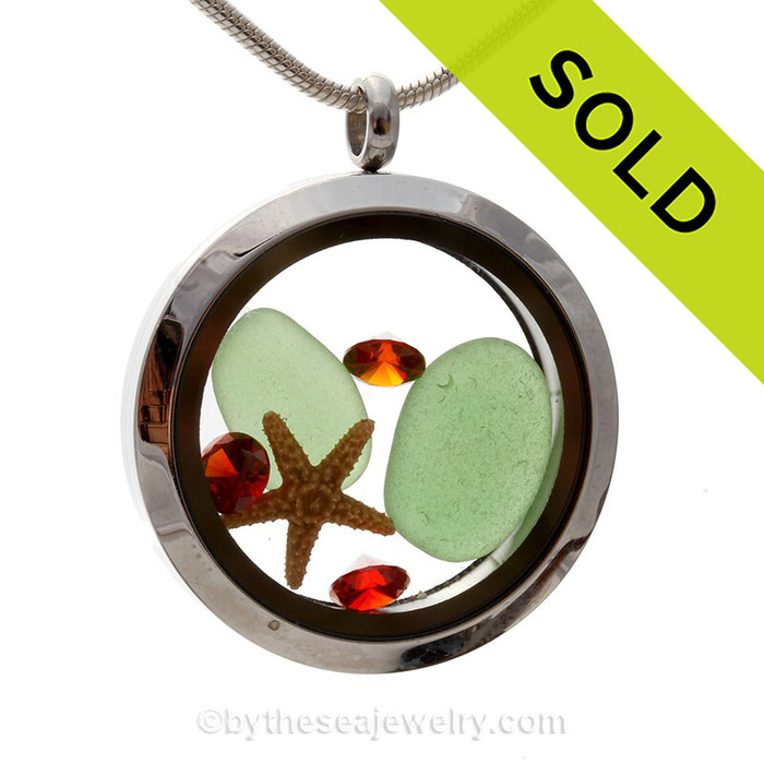 Green sea glass and a real starfish make this a great locket necklace for the holidays. Ruby Red crystal gems finish the locket with some extra bling.