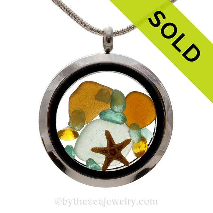 A great locket for anyone, specially those with a November birthday. Amber and Aqua sea glass combined with a real starfish and brightened up with a Topaz crystal gems (November Birthstone). SOLD - Sorry this Sea Glass Jewelry selection is NO LONGER AVAILABLE!
