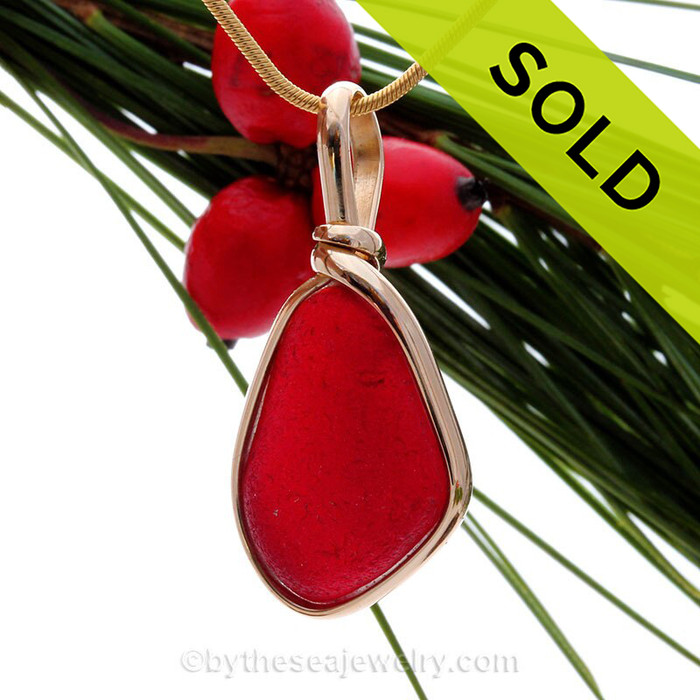A once in a lifetime piece of large bright cherry red sea glass is set in our Original Wire Bezel© pendant setting.