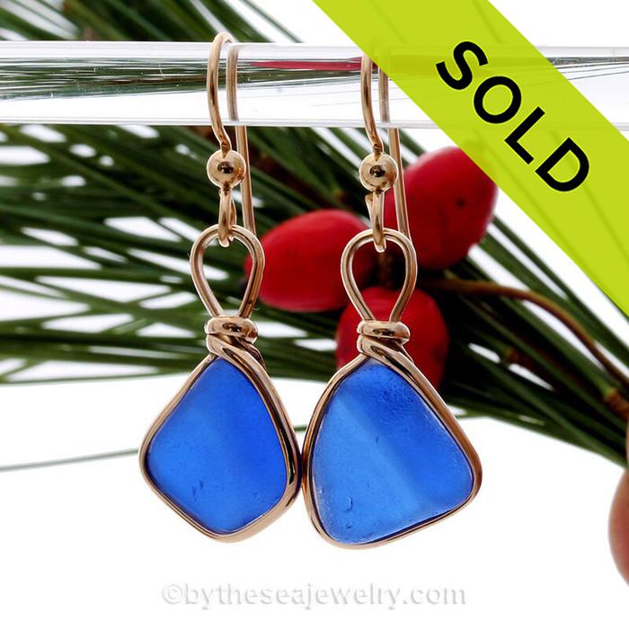 A beautiful vivid blue ridged sea glass pieces set in a gold bezel setting