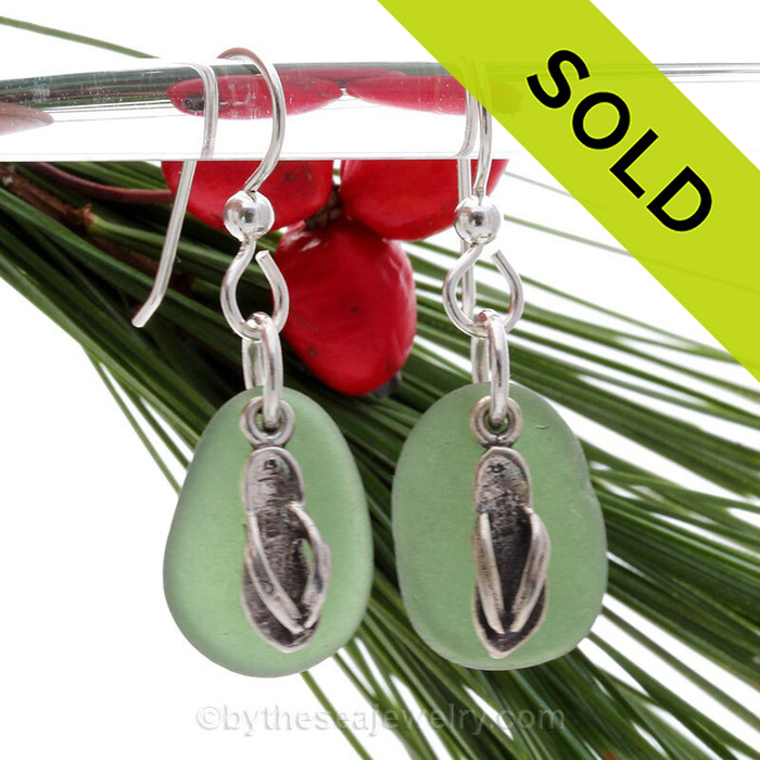 Great pieces of top quality sea glass in green on a secure simple sterling setting combined with solid sterling Flip Flop Charms
