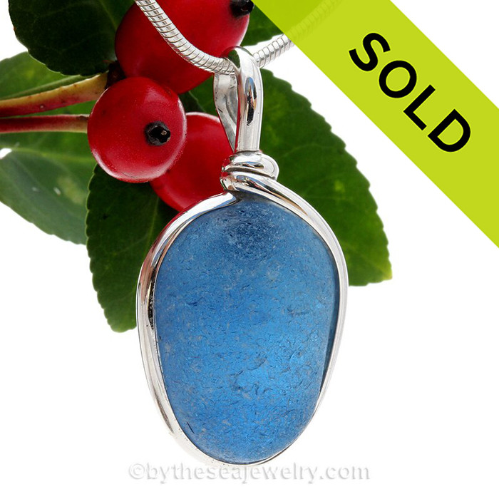 A beautiful very frosty piece of  subtle mixture of Carolina Blue sea glass set in our Original Wire Bezel© setting om Solid Sterling Silver. A great sea glass pendant for any necklace.