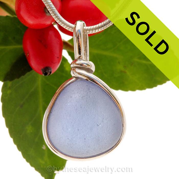 A beautiful piece Voluptuous Violet Sea glass is set in our Original Wire Bezel© sea glass pendant setting.