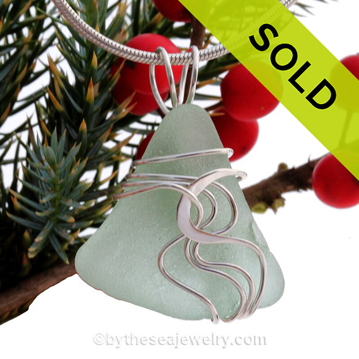 A nice TOP QUALITY piece of  Seafoam Green Genuine Sea Glass Pendant set in our Signature Waves© setting in Sterling Silver.