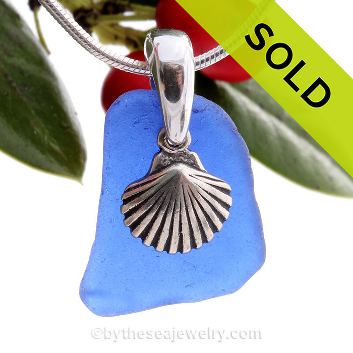 Beach found cobalt blue sea glass is combined with a solid sterling bail and finished with a S/S detailed Sea Shell Charm on an 18 Inch solid sterling snake chain.