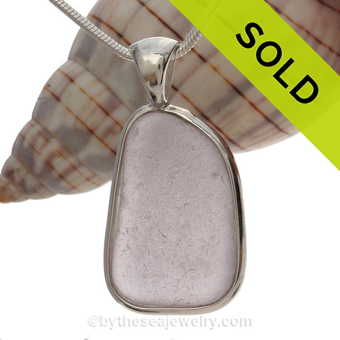 A nice large classically set sea glass pendant in a rare color