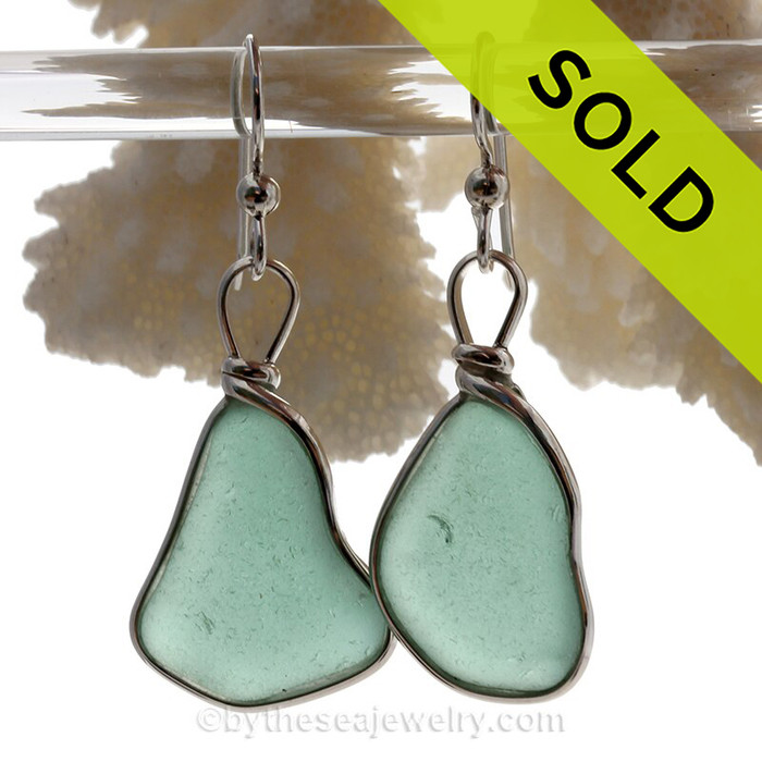 Natural Genuine beach found sea glass pieces in an unusual teal green expertly wrapped in a Solid Sterling custom bezel for a lovely classic pair of genuine beach found sea glass earrings!