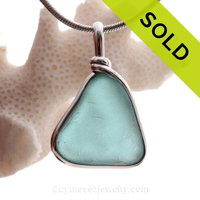 Smaller Aqua Blue Sea Glass in our Original Wire Bezel© pendant setting in solid sterling silver.