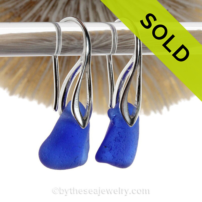 Cobalt Blue Beach Found Sea Glass Earrings On Silver Silver Deco Hooks  An elegant pair of natural beach found Sea Glass Earrings in a classic Cobalt Blue on Sterling Silver Deco Hooks.
