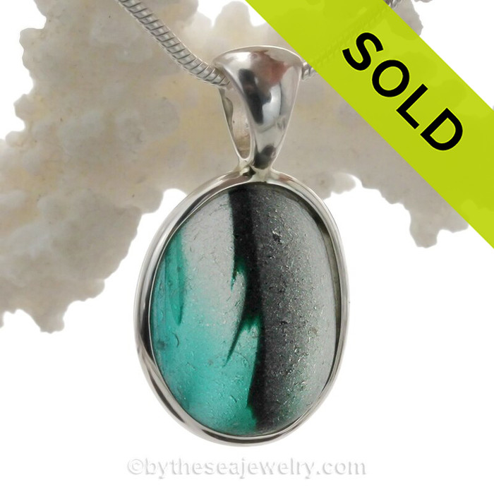 A really cool sea glass piece from Seaham England in an organic teal mixed pendant.