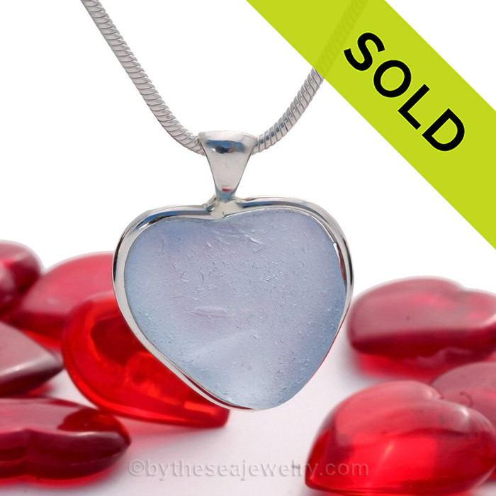 A beautiful Lovey Ice Blue natural Sea Glass Heart Pendant set in our Deluxe Wire Bezel© setting in Solid Sterling Silver.