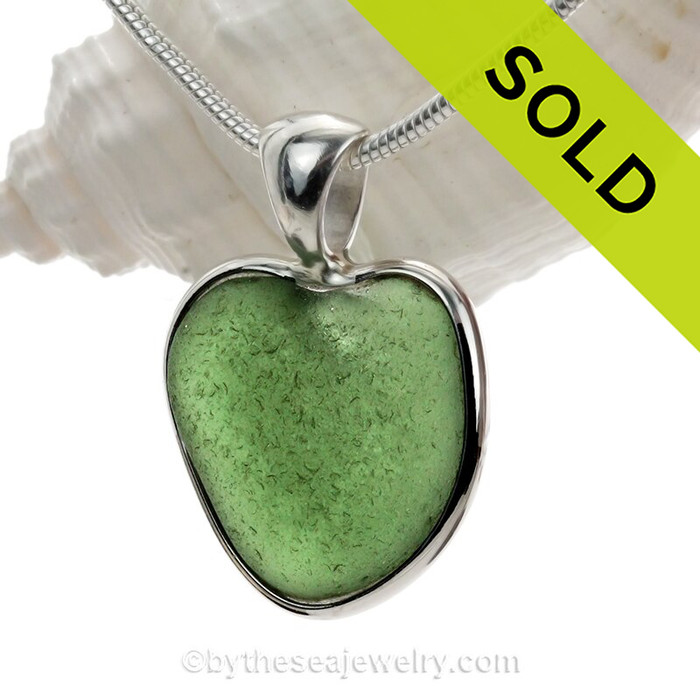 A small natural seaweed  green sea glass heart set in our Deluxe Wire Bezel© A great necklace for any time of year and perfect for any sea glass lover!