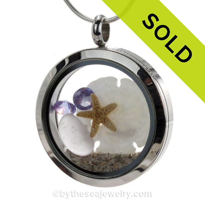 Stunning early 20th century purple or lavender sea glass combined with beach sand ,a baby starfish and sandolllar and brightened up with amethyst gems makes this a great choice for a February Birthday!